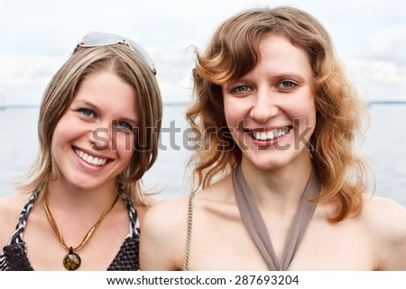 Faces of happy smiling Caucasian women, looking at camera - stock photo