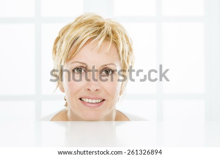 Facet of nice, forty years old woman - stock photo