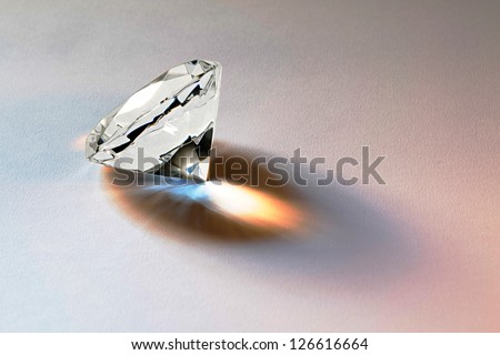 Faceted diamond gemstone with brilliant internal refraction to be mounted in jewelry or bought as a loose stone for investment - stock photo