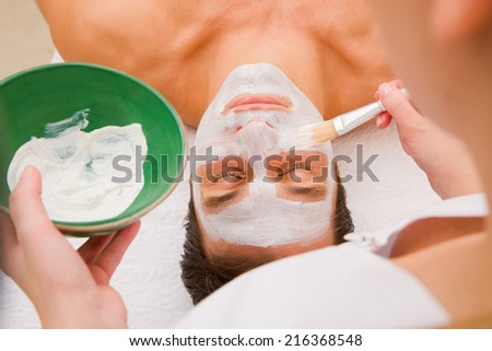 Facial beauty treatment by an aesthetician - stock photo