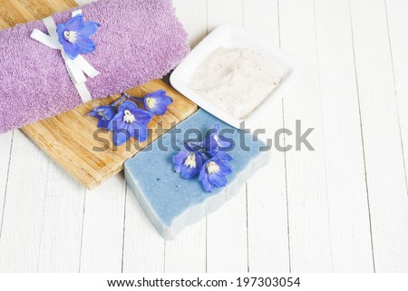 facial cleanser and handmade organic soap wood background
