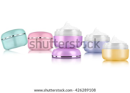 Facial cosmetic cream assortment of various colors, isolated on white background