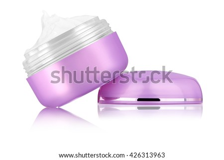 Facial cosmetic cream on blank purple glossy can, sitting on lid, reflected on the surface, isolated on white background