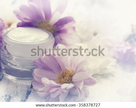 facial cream with flowers, freshness
