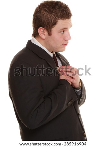 Facial expression body language. Desperate young man showing clasped hands asking forgiveness, praying isolated - stock photo