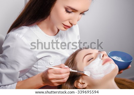 Facial mask Cosmetic procedure at beauty salon - stock photo