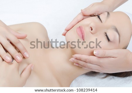Facial massage to the woman close up - stock photo