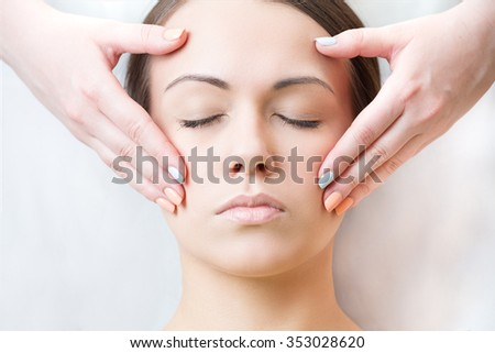 facial massage to tighten the skin around the eyes - stock photo