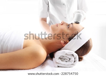 Facial treatment, ultrasound,The woman's face during a facial at a beauty salon  - stock photo