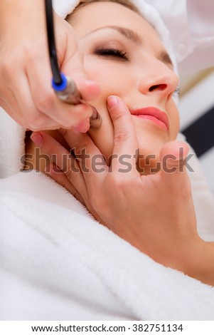 facial treatments at the beauty salon - stock photo