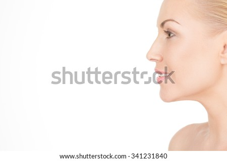 Facing age with a smile on her face. Cropped profile of a gorgeous blonde woman smiling widely isolated on white - stock photo