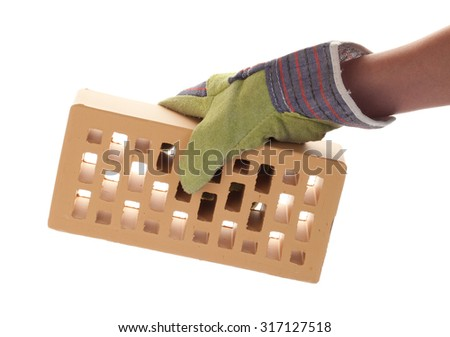 Facing brick in hand with the construction glove isolated on white background - stock photo