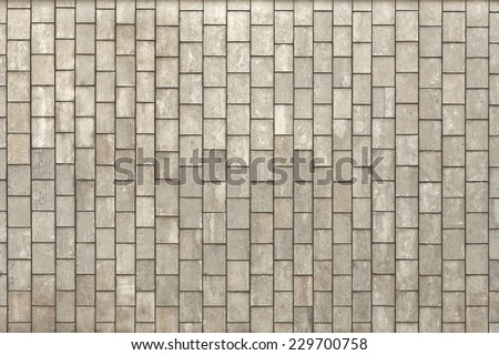 Facing gray tiles as a vintage background - stock photo