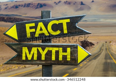 Fact - Myth signpost in a desert road on background - stock photo