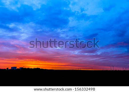 factory and wind power silhouette with Clouds in the light of the sunset  - stock photo