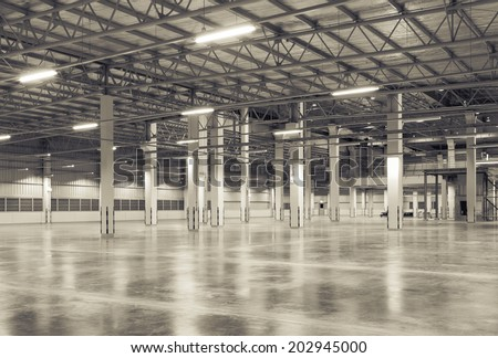 Factory background with concrete floor, night scene - stock photo