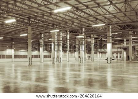 Factory background with concrete floor, night scene - stock photo