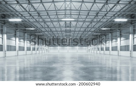 Factory building or warehouse building with concrete floor for background. - stock photo