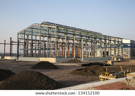 Factory building under construction - stock photo