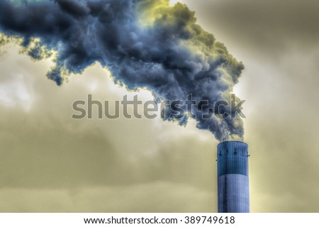 factory chimney emitting dark smoke / HDR shot