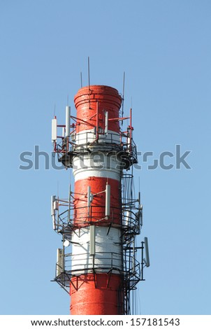 Factory chimney of red brick with white horizontal stripes