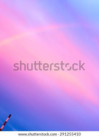Factory chimneys and rainbow.  - stock photo