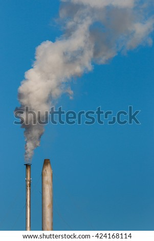 factory chimneys with smoke  - stock photo