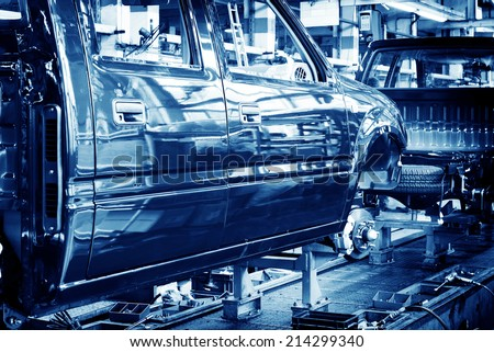 Factory floor, car production lines. - stock photo