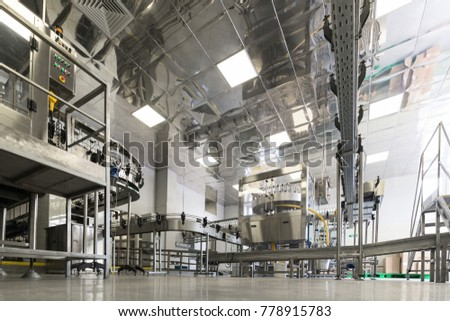 Factory for bottling alcoholic beverages. Abstract industrial background.