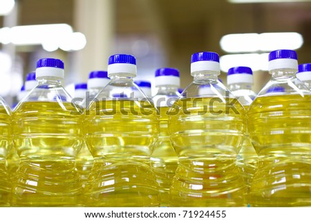 Factory for the production of edible oils. Shallow DOFF. Selective focus. The focus is on the second shutter on the right. - stock photo