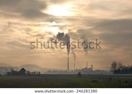 Factory landscape at sunset - stock photo