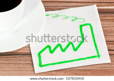 Factory on a napkin and cup of coffee - stock photo
