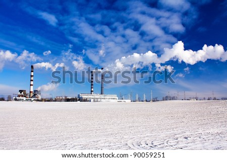 Factory on manufacture of chemical production in a winter season - stock photo