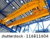 factory overhead crane - stock photo