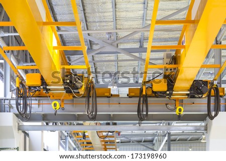 Factory overhead crane inside factory building.