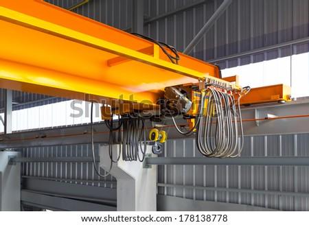 Factory overhead crane inside factory building. - stock photo