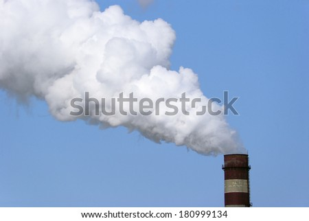 Factory pipe and white cloud of pollution - stock photo