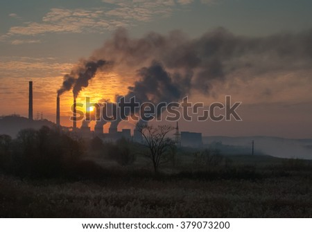 Factory pipe polluting air, smoke from chimneys against sunset, environmental problems, ecology theme - stock photo