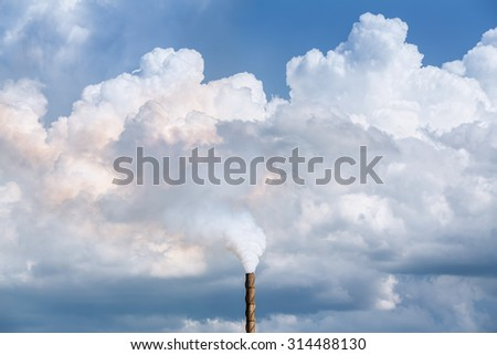 Factory pipe smoking with a white smoke over the sky