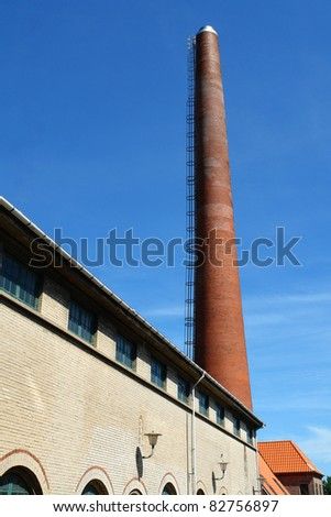 Factory plant building with a chimney vertical industry manufacturing  background
