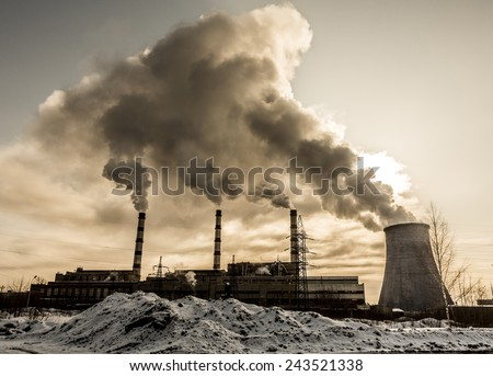 Factory pollutes the atmosphere harmful emissions - stock photo