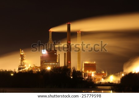 Factory smoke at night with long exposure effect - stock photo