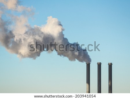 Factory smoke stack air pollution - stock photo