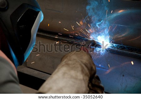 Factory welder doing his job