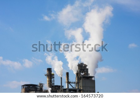 Factory with smoke coming out of smokestacks