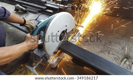 Factory worker using electric grinder - a series of METAL INDUSTRY images.