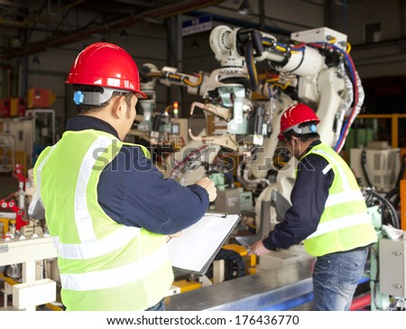 Factory workers team on working - stock photo