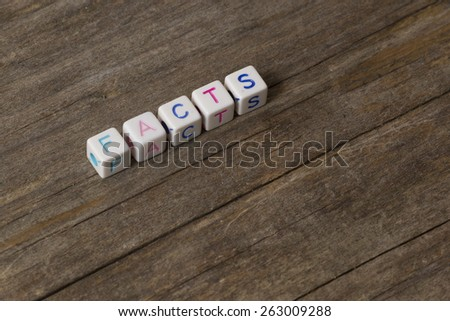 FACTS word on a wooden background - stock photo