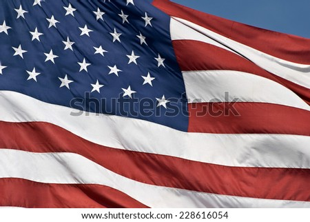 Faded Flying American Flag With Blue Sky/ Horizontal Shot - stock photo