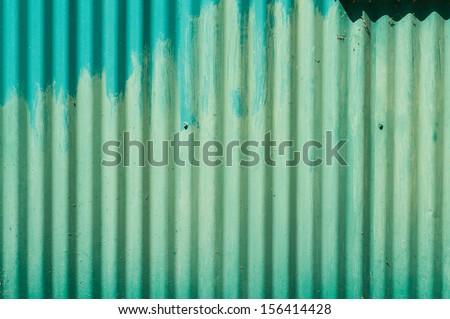Faded green metal wall - stock photo